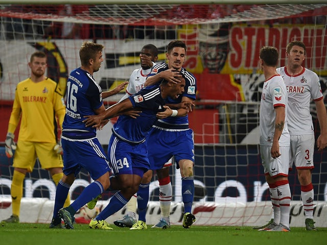 Ingolstadt's defender Marvin Matip and his teammates celebrate scoring during the German first division Bundesliga football match FC Cologne vs FC Ingolstadt 04 in Cologne, western Germany on September 25, 2015