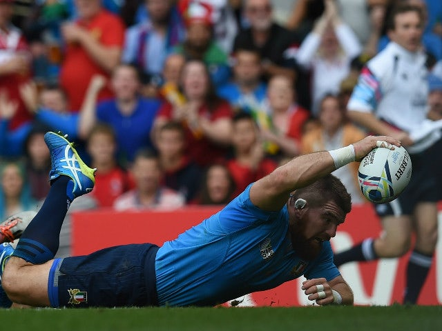 Italy's prop Michele Rizzo scores a try during a Pool D match of the 2015 Rugby World Cup between Italy and Canada at Elland Road in Leeds, north England, on September 26, 2015.