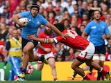 Italy's scrum half Edoardo Gori (L) evades a tackle by Canada's fly half Nathan Hirayama during a Pool D match of the 2015 Rugby World Cup between Italy and Canada at Elland Road in Leeds, north England, on September 26, 2015.