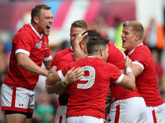 D. T. H. van der Merwe of Canada celebrates his try with team mates during the 2015 Rugby World Cup Pool D match between Italy and Canada at Elland Road on September 26, 2015 in Leeds, United Kingdom.