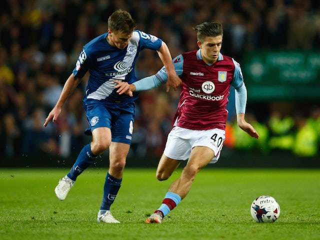 Jack Grealish of Aston Villa holds off Stephen Gleeson of Birmingham City during the Capital One Cup third round match between Aston Villa and Birmingham City at Villa Park on September 22, 2015 in Birmingham, England.