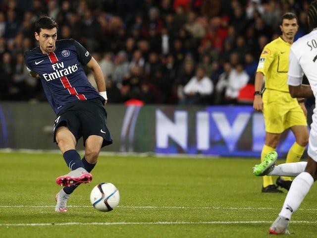 Paris Saint-Germain's Argentinian midfielder Javier Pastore (L) kicks to score a goal during the French L1 football match between Paris Saint-Germain (PSG) and EA Guingamp on September 22, 2015 at the Parc des Princes stadium in Paris.