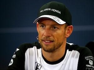 Jenson Button to remain with McLaren