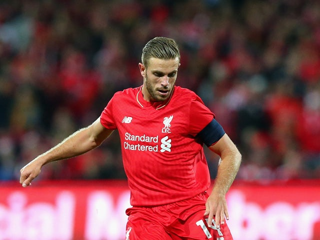 Jordan Henderson of Liverpool FC passes the ball during the international friendly match between Adelaide United and Liverpool FC at Adelaide Oval on July 20, 2015