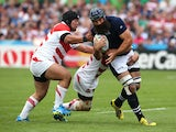 Josh Strauss of Scotland is tackled during the 2015 Rugby World Cup Pool B match between Scotland and Japan at Kingsholm Stadium on September 23, 2015