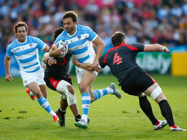 an Martin Hernandez of Argentina goes past Giorgi Nemsadze of Georgia during the 2015 Rugby World Cup Pool C match between Argentina and Georgia at Kingsholm Stadium on September 25, 2015