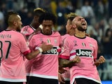 Juventus' forward from Italy Simone Zaza (R) celebrates after scoring a goal during the Serie A football match Juventus vs Frosinione at 'Juventus Stadium' in Turin on September 23, 2015