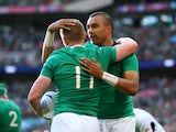 Keith Earls (L) of Ireland celebrates his teams second try with Simon Zebo during the 2015 Rugby World Cup Pool D match between Ireland and Romania at Wembley Stadium on September 27, 2015