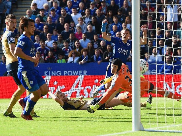 Jamie Vardy of Leicester City scores his team's first goal past Petr Cech of Arsenal during the Barclays Premier League match between Leicester City and Arsenal at The King Power Stadium on September 26, 2015 in Leicester, United Kingdom.