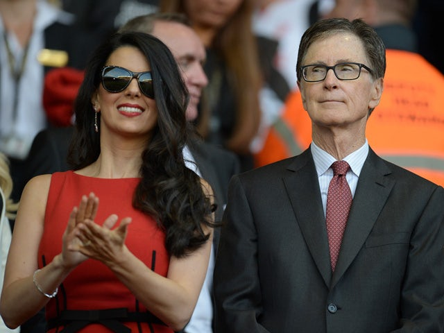 Liverpool's US owner John W. Henry (R) and his wife Linda Pizzuti are pictured before the start of the English Premier League football match between Liverpool and Bournemouth at the Anfield stadium in Liverpool, north-west England on August 17, 2015