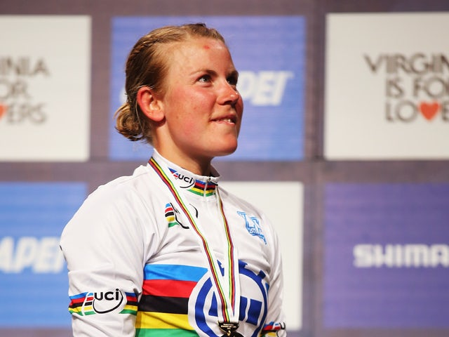 Linda Melanie Villumsen of New Zealand stands on the podium after winning the Women's Elite Individual Time Trial during day three of the UCI Road World Championships on September 22, 2015