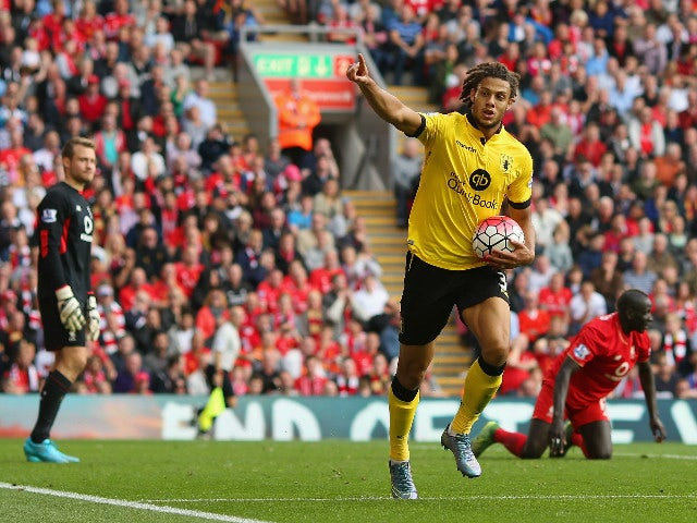 Rudy Gestede of Aston Villa celebrates scoring his team's second goal during the Barclays Premier League match between Liverpool and Aston Villa at Anfield on September 26, 2015 in Liverpool, United Kingdom.