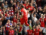 Liverpool's English midfielder James Milner celebrates after scoring his team's first goal during the English Premier League football match between Liverpool and Aston Villa at the Anfield stadium in Liverpool, north-west England, on September 26, 2015.