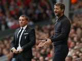 Aston Villa's English manager Tim Sherwood (R) and Liverpool's Northern Irish manager Brendan Rodgers instruct their teams during the English Premier League football match between Liverpool and Aston Villa at the Anfield stadium in Liverpool, north-west E