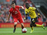 Idrissa Gueye of Aston Villa and James Milner of Liverpool compete for the ball during the Barclays Premier League match between Liverpool and Aston Villa at Anfield on September 26, 2015 in Liverpool, United Kingdom.