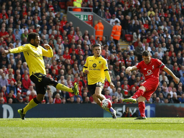 Liverpool's English midfielder James Milner (2nd R) scores his team's first goal during the English Premier League football match between Liverpool and Aston Villa at the Anfield stadium in Liverpool, north-west England, on September 26, 2015.