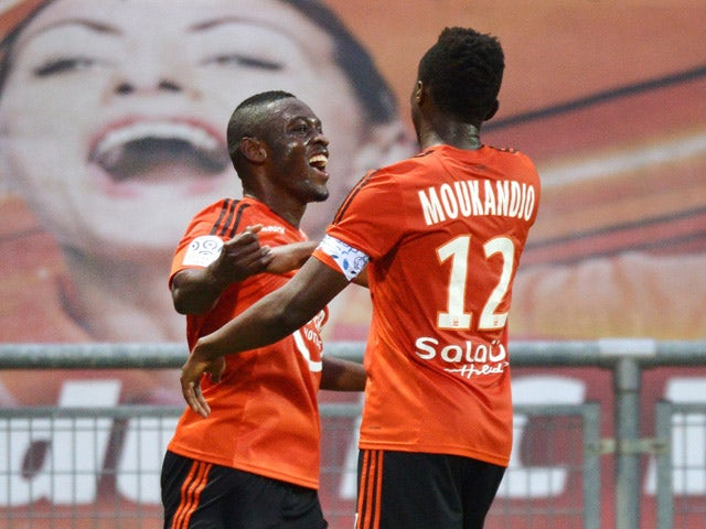 Lorient's Cameroonian forward Waris Majeed celebrates with his teammate Lorient's Cameroonian forward Benjamin Moukandjo after scoring a goal during the French L1 football match between Lorient and Caen on September 23, 2015