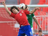 Luka Jovic (L) of Serbia jumps for the ball against Benedikt Gimber (R) of Germany during the UEFA Under17 Elite Round between Serbia and Germany at Stadion Karadjordje on March 31, 2014 in Novi Sad, Serbia.