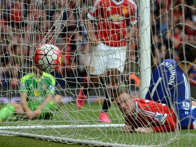 Manchester United's English striker Wayne Rooney (2nd R) watches the ball hit the back of the Sunderland net as he scores their second goal during the English Premier League football match between Manchester United and Sunderland at Old Trafford in Manche