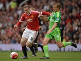 Manchester United's English striker Wayne Rooney (L) vies with Sunderland's English midfielder Lee Cattermole during the English Premier League football match between Manchester United and Sunderland at Old Trafford in Manchester, north west England, on S