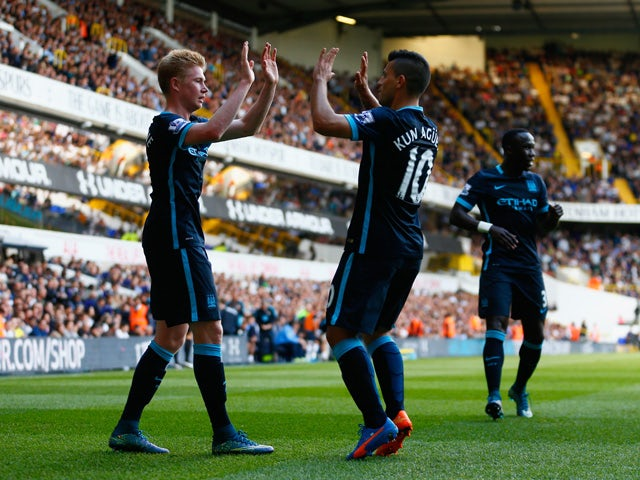 Kevin de Bruyne (L) of Manchester City celebrates scoring his team's first goal with his team mate Sergio Aguero (R) during the Barclays Premier League match between Tottenham Hotspur and Manchester City at White Hart Lane on September 26, 2015
