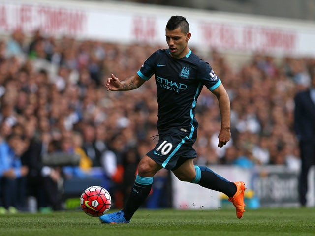 Manchester City's Argentinian striker Sergio Aguero runs with the ball during the English Premier League football match between Tottenham Hotspur and Manchester City at White Hart Lane in north London on September 26, 2015