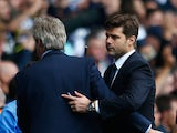 Manuel Pellegrini (L), manager of Manchester City shows congratulates Mauricio Pochettino (R) Manager of Tottenham Hotspur after the Barclays Premier League match between Tottenham Hotspur and Manchester City at White Hart Lane on September 26, 2015