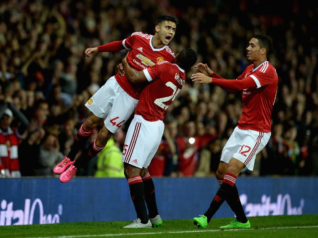 Andreas Pereira of Manchester United celebrates with Antonio Valencia after scoring his team's second goal during the Capital One Cup Third Round match between Manchester United and Ipswich Town at Old Trafford on September 23, 2015