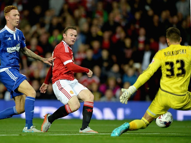 Wayne Rooney of Manchester United scores the opening goal past Bartosz Bialkowski of Ipswich Town during the Capital One Cup Third Round match between Manchester United and Ipswich Town at Old Trafford on September 23, 2015