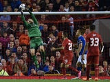 Carlisle United's English goalkeeper Mark Gillespie (L) claims the ball during the English League Cup third round football match between Liverpool and Carlisle United at Anfield in Liverpool, north west England on September 23, 2015