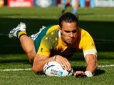 Matt Toomua of Australia dives over to score their tenth try during the 2015 Rugby World Cup Pool A match between Australia and Uruguay at Villa Park on September 27, 2015