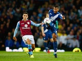 Michael Morrison of Birmingham City is marshalled by Ashley Westwood of Aston Villa during the Capital One Cup third round match between Aston Villa and Birmingham City at Villa Park on September 22, 2015 in Birmingham, England.