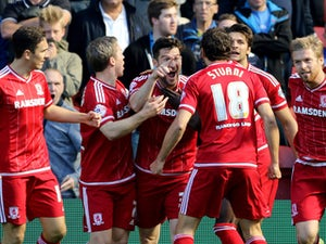 Middlesbrough's David Nugent celebrates with team-mates after scoring the opening goal during the Sky Bet Championship match between Middlesbrough and Leeds United at the Riverside on September 27, 2015