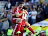 Middlesbrough's Stewart Downing celebrates with Middlesbrough's Christian Stuani after the opening goal during the Sky Bet Championship match between Middlesbrough and Leeds United at the Riverside on September 27, 2015