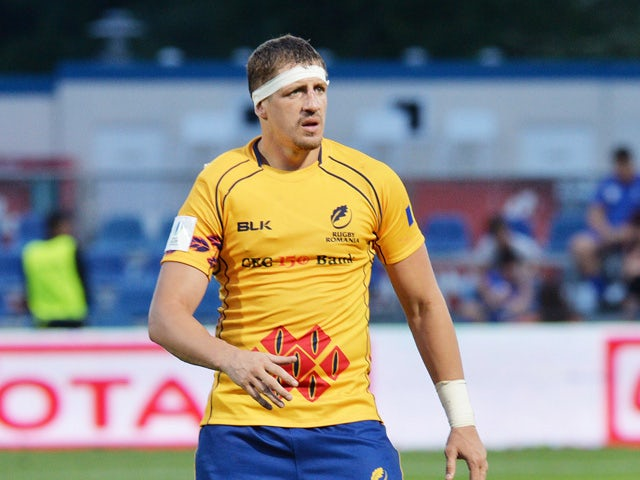 Mihai Macovei of Romania runs during the IRB Nations Cup rugby tournament match against Romania in Bucharest June 17, 2015