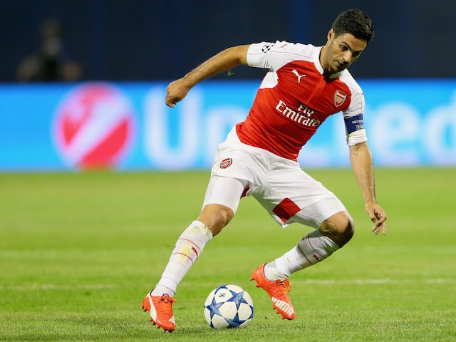 Mikel Arteta of Arsenal runs with the ball during the UEFA Champions League Group F match between Dinamo Zagreb and Arsenal at Maksimir Stadium on September 16, 2015 in Zagreb, Croatia.