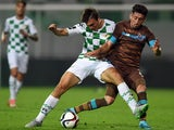 Moreirense's midfielder Joao Palhinha (L) vies with Porto's Mexican midfielder Hector Herrera during the Portuguese league football match Moreirense FC vs FC Porto at the Comendador Joaquim de Almeida Freitas stadium in Moreira de Conegos on Spetember 25,