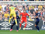Nantes' French forward Yacine Bammou (L) scores a goal during the French L1 football match between Nantes (FCN) and Paris Saint-Germain (PSG) on September 26, 2015