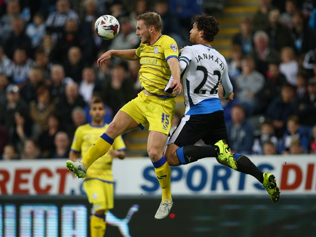 Tom Lees of Sheffield Wednesday vies with Daryl Janmaat of Newcastle United during the Capital One Cup Third Round match between Newcastle United and Sheffield Wednesday at St James Park on September 23, 2015