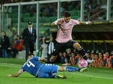 Achraf Lazaar (R) of Palermo jumps as Francesco Manganelli of Sassuolo tackles the Serie A match between US Citta di Palermo and US Sassuolo Calcio at Stadio Renzo Barbera on September 23, 2015