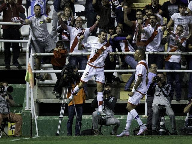 Roberto Tashorras (L) of Rayo Vallecano de Madrid celebrates scoring their opening goal during the La Liga match between Rayo Vallecano de Madrid and Real Sporting de Gijon at Estadio de Vallecas on September 23, 2015