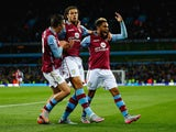 Rudy Gestede of Aston Villa (C) celebrates scoring their first with Jack Grealish and Jordan Amavi of Aston Villa during the Capital One Cup third round match between Aston Villa and Birmingham City at Villa Park on September 22, 2015 in Birmingham, Engla