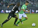 Nice's Ivorian midfielder Jean Michel Seri (L) vies with Saint-Etienne's French defender Kevin Malcuit during the French L1 football match between Saint-Etienne (ASSE) and Nice (OGCN) at Geoffroy Guichard Stadium in Saint-Etienne, central France, on Septe