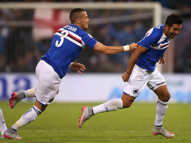 Sampdoria's forward Citadin Martins Eder (R ) is congratulated by his teammate Djamel Mesbah from Algeria after scoring a goal during the Italian Serie A football match Sampdoria vs Roma on September 23, 2015
