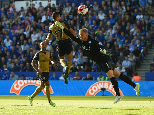 Alexis Sanchez (C) of Arsenal scores his team's third goal during the Barclays Premier League match between Leicester City and Arsenal at The King Power Stadium on September 26, 2015 in Leicester, United Kingdom.