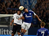Frankfurt's Peruvian defender Carlos Zambrano (L) and Schalke's Dutch striker Klaas-Jan Huntelaar vie for the ball during the German first division Bundesliga football match FC Schalke 04 v Eintracht Frankfurt in Gelsenkirchen, on September 23, 2015