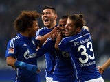 Schalke's Cameroonian defender Joel Matip (C) and his teammates celebrate after 1-0 during the German first division Bundesliga football match FC Schalke 04 v Eintracht Frankfurt in Gelsenkirchen, on September 23, 2015
