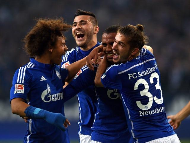 Schalke's Cameroonian defender Joel Matip (C) and his teammates celebrate after 1-0 during the German first division Bundesliga football match FC Schalke 04 v Eintracht Frankfurt in Gelsenkirchen, on September 23, 2015