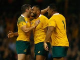 Sekope Kepu of Australia celebrates scoring his teams third try with team mates during the 2015 Rugby World Cup Pool A match between Australia and Fiji at the Millennium Stadium on September 23, 2015
