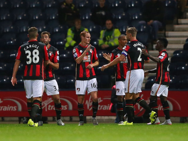 Shaun MacDonald of Bournemouth (16) celebrates with team mates as he scores their first goal during the Capital One Cup third round match between Preston North End and AFC Bournemouth at Deepdale on September 22, 2015 in Preston, England.